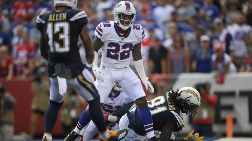 Buffalo Bills' Vontae Davis, center, gets up after Los Angeles Chargers' Mike Williams, right, score