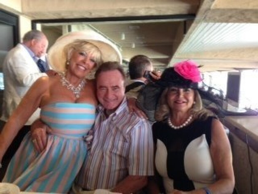 Fred Applegate with Judy Ferrero (left) and Susan Parker on opening day of the Del Mar Racetrack.