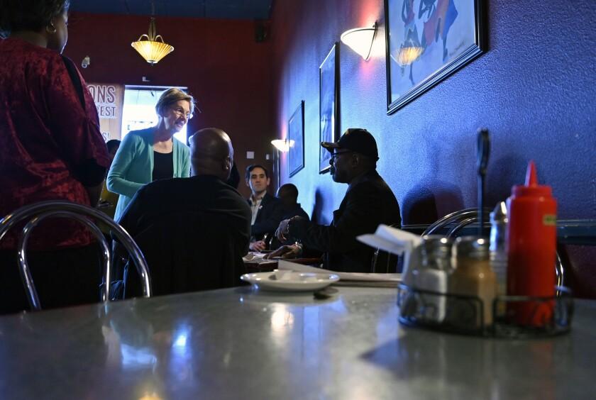Sen. Elizabeth Warren speaks at EllaEm's Soul Food restaurant in North Las Vegas, Nev.