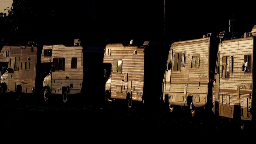 More than 9,100 vehicles are used as residences in L.A. County, according to the 2018 Greater Los Angeles Homeless Count. County officials hope to reduce that number while providing vehicle dwellers with more services. Above, a line of RVs parked in South Los Angeles.