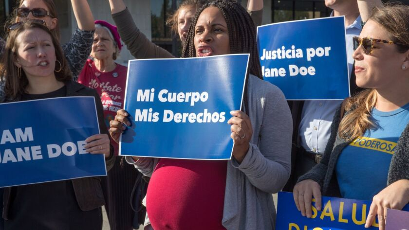 Activists with Planned Parenthood demonstrate in support of a pregnant 17-year-old being held in a T