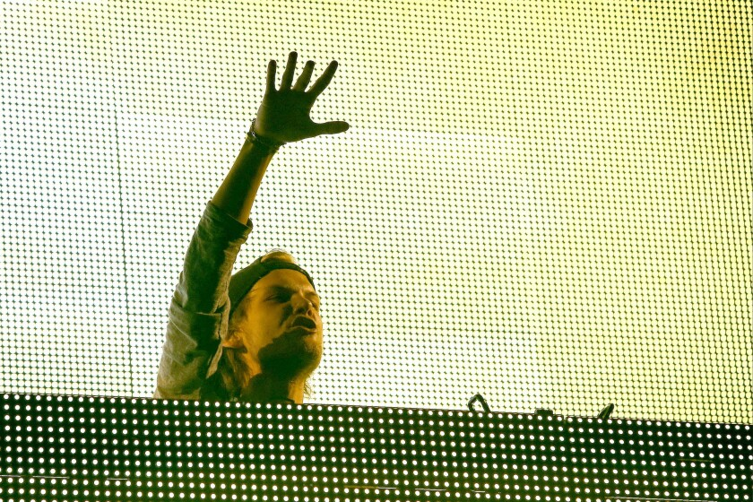 Avicii performs during the KROQ Weenie Roast at the Verizon Wireless Amphitheater on Saturday, May 31, 2014 in Irvine, Calif. The DJ has announced his retirement from touring.