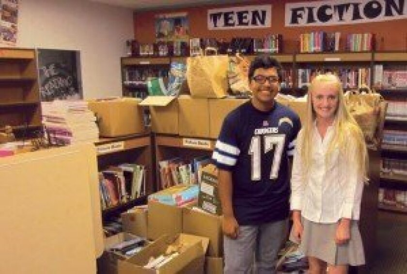 Sarah Lackey and her Books for Friends nonprofit delivered 3,218 books to the Monarch School library in August.