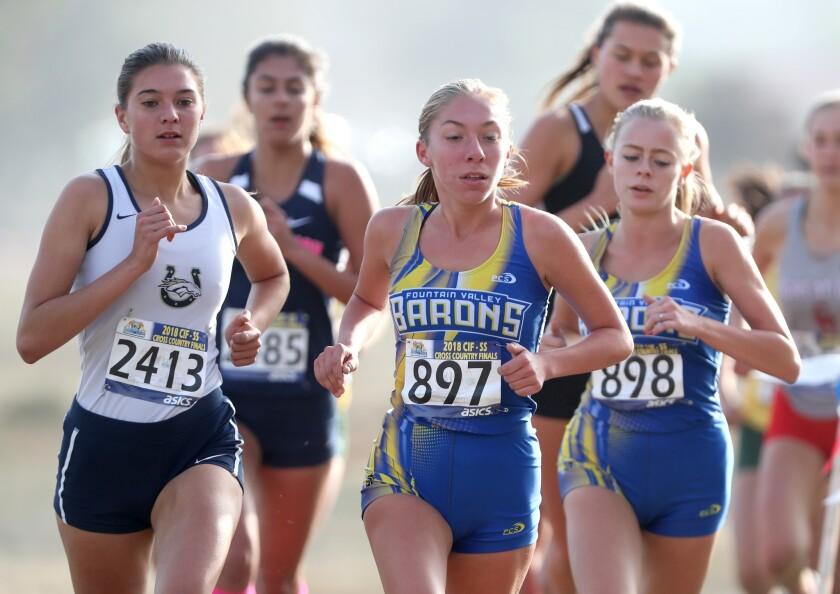 Fountain Valley High School runner Ashley Faller, center, and Sara Feitz, right, ran in the girls'