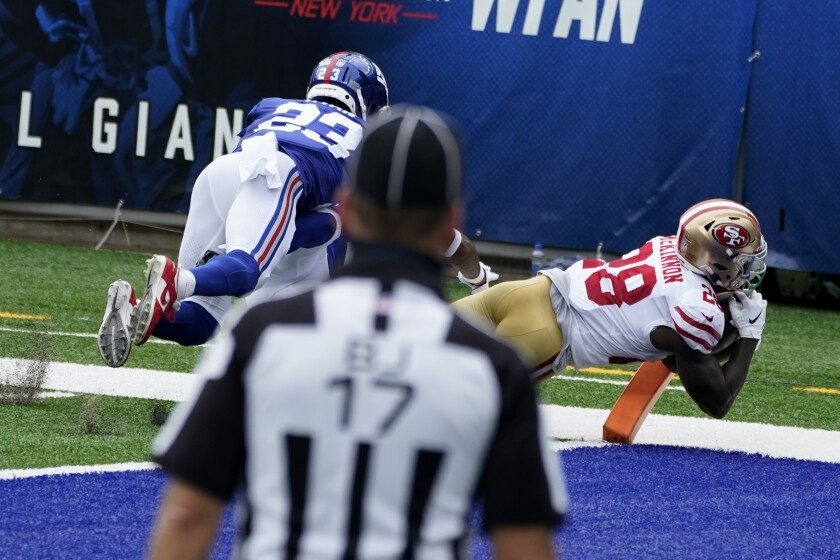 San Francisco 49ers' Jerick McKinnon, right, scores a touchdown in front of New York Giants' Logan Ryan during the first half of an NFL football game, Sunday, Sept. 27, 2020, in East Rutherford, N.J. (AP Photo/Corey Sipkin)