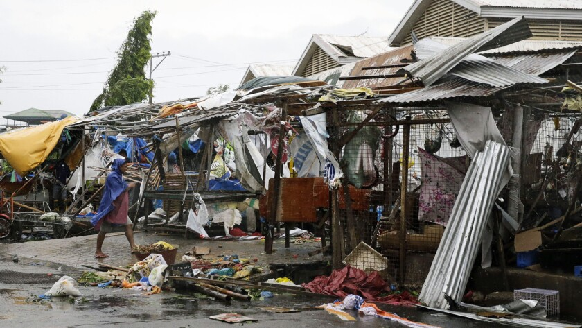 A resident examines market stalls destroyed after Typhoon Mangkhut barreled across Tuguegarao, a city in Cagayan province in the northeastern Philippines.