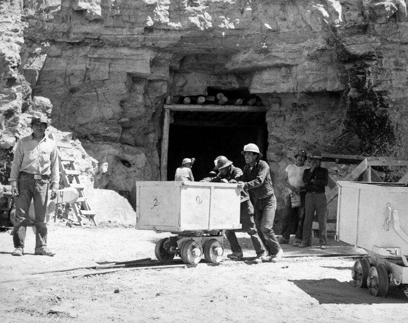 FILE - In this May 7, 1953, file photo, Navajo miners work at the Kerr McGee uranium mine at Cove, Ariz., on the Navajo reservation in Arizona. Kerr-McGee left abandoned uranium mine sites, including contaminated waste rock piles, in the Lukachukai mountains of Arizona and in the Ambrosia Lake area