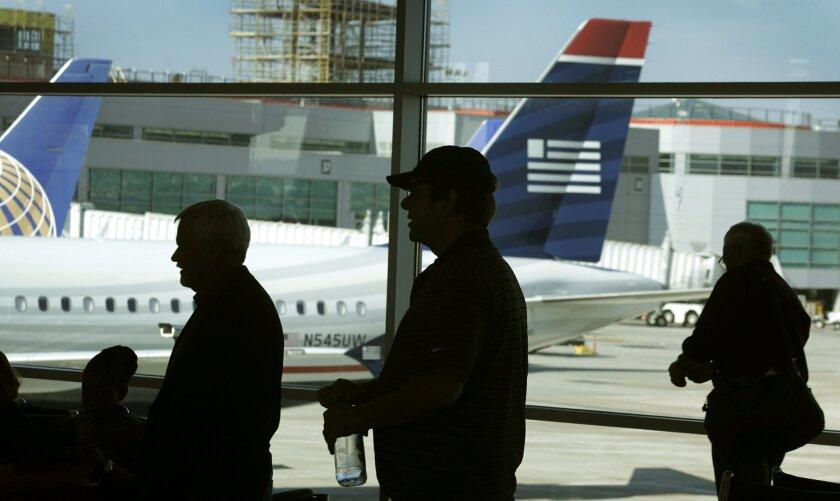 Passengers wait to board a flight at San Diego International Airport Lindbergh Field.