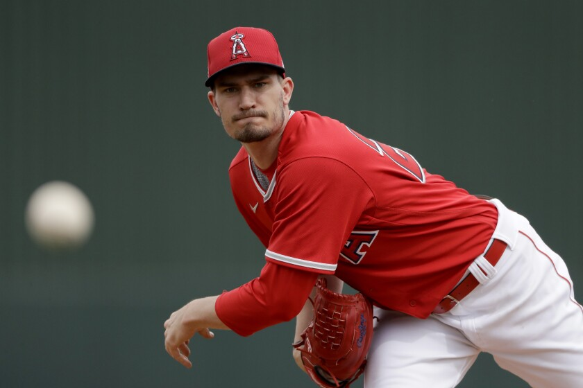 FILE - In this Feb. 28, 2020, file photo, Los Angeles Angels starting pitcher Andrew Heaney throws during the first inning of a spring training baseball game against the Texas Rangers in Tempe, Ariz. Left-hander Heaney is expected to make his first opening day start for the Angels. Manager Joe Maddon confirmed his selection Sunday, July 5, 2020, before the Angels' third workout of summer camp. Los Angeles is expected to open the season July 24. (AP Photo/Charlie Riedel, File)