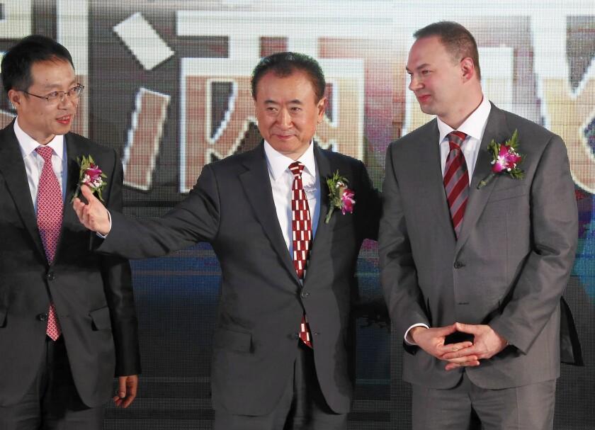 Wang Jianlin, center, chairman of China's Wanda Group, with Thomas Tull, right, CEO of U.S. film company Legendary, after Wanda Group's $3.5-billion acquisition.