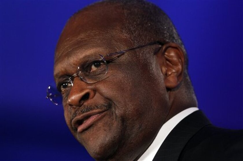 """FILE - In this June 17, 2011, file photo Republican presidential hopeful Herman Cain speaks at the Republican Leadership Conference in New Orleans, La. On ABC's This Week on Sunday, Oct. 21, 2011, Cain said he should not have stayed silent after the audience at a GOP debate booed a gay soldier serving in Iraq. He said it would have been """"appropriate"""" for him to have defended the soldier. None of the candidates on stage at the Sept. 22 forum responded to the boos. (AP Photo/Pat Semansky, File) The Georgia businessman told ABC's This Week on Sunday that it would have been """"appropriate"""" for him to have asked the audience to respect the soldier. (AP Photo/Patrick Semansky)"""