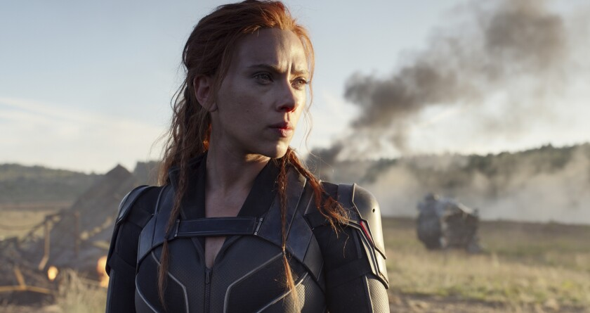 """This image released by Disney/Marvel Studios' shows Scarlett Johansson in a scene from """"Black Widow."""" The Walt Disney Co. has further postponed its next mega-movies from Marvel, including """"Black Widow,"""" while also postponing Steven Spielberg's """"West Side Story"""" a full year in the company's latest recalibration due to the pandemic. (Marvel Studios/Disney via AP)"""