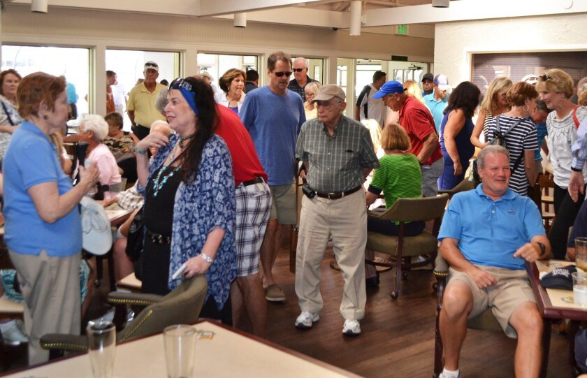 Hundreds of members of the public packed the bar and dining area of Stoneridge Country Club to discuss the future of the club's golf course.