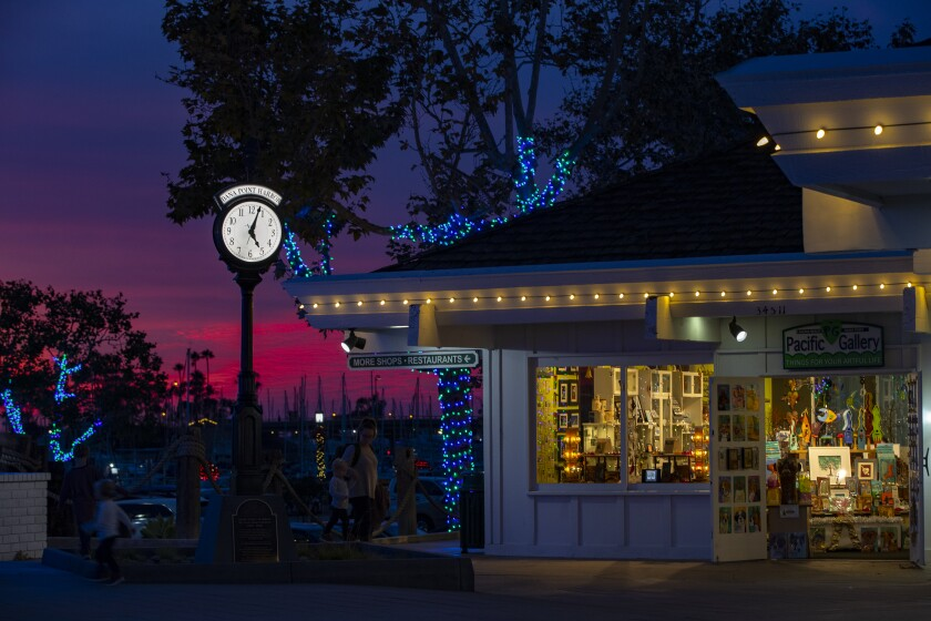 Sunsets, holiday lights and vintage beachfront shops in Dana Point Harbor