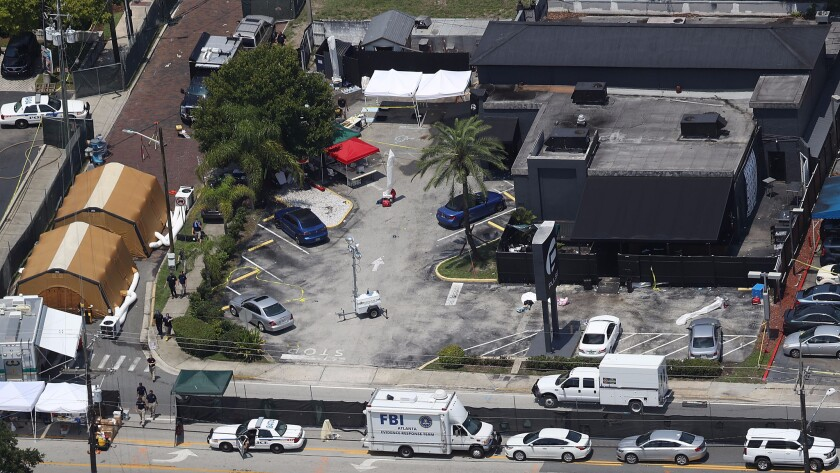 Law enforcement officials investigate the Pulse nightclub in Orlando, Fla., where Omar Mateen gunned down 49 people in June.