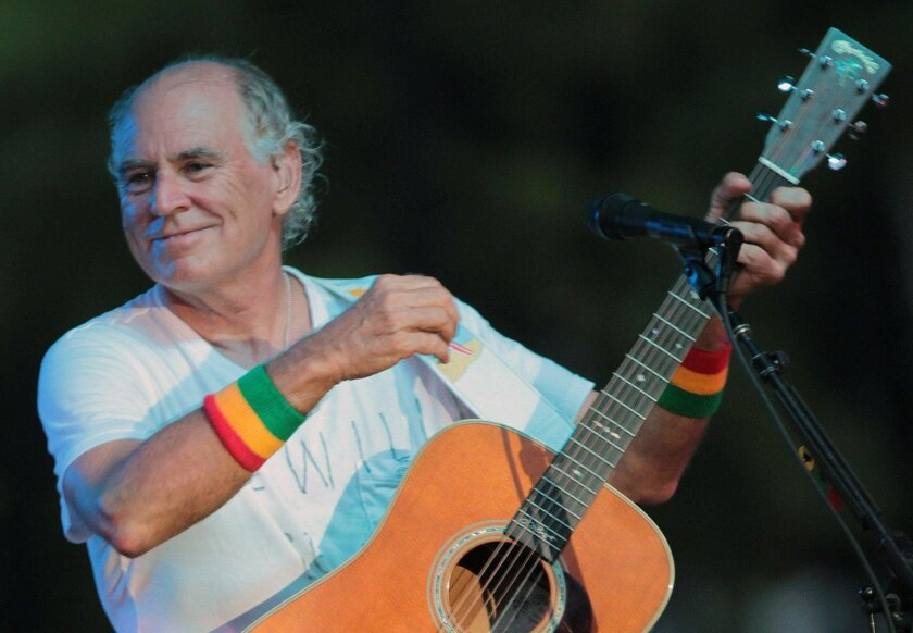 """FILE - In this June 30, 2010, file photo, Jimmy Buffett performs at his sister's restaurant in Gulf Shores, Ala. The Jimmy Buffett musical making its world premiere in 2017 in California has a new name and a Tony Award-winning creative support team. The musical is now titled """"Escape to Margaritavil"""
