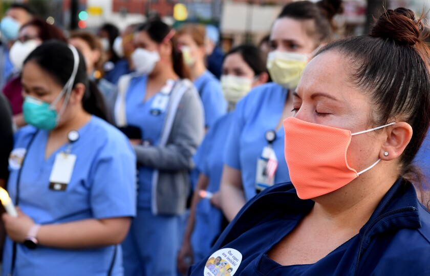 Monique Hernandez, a registered nurse, attends a vigil for nurse Celia Marcos.