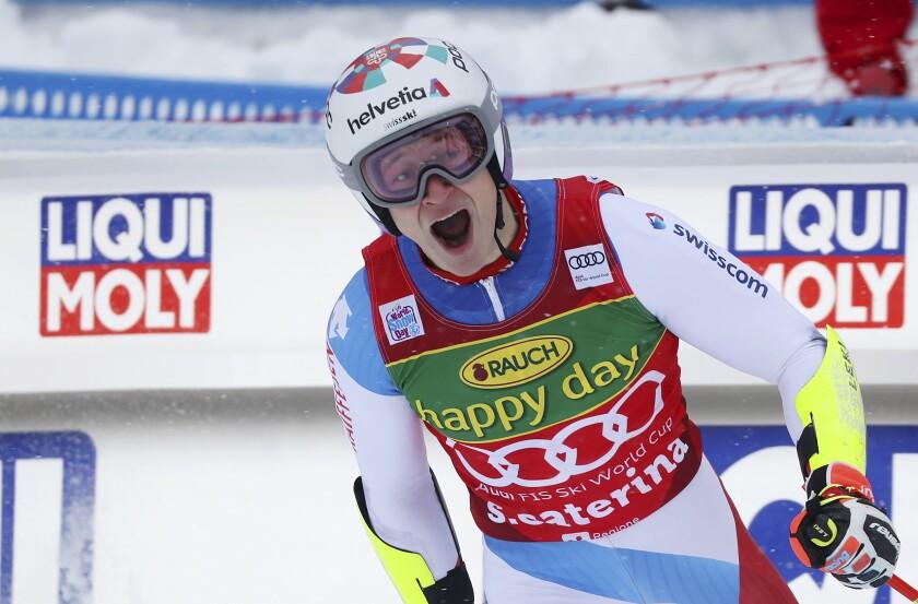 Switzerland's Marco Odermatt celebrates as he arrives at the finish area during the second run of an alpine ski, World Cup men's giant slalom in Santa Caterina Valfurva, Italy, Monday, Dec. 7, 2020. (AP Photo/Alessandro Trovati)