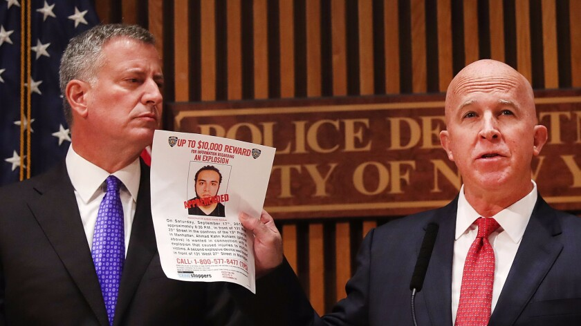 New York City Police Commissioner James O'Neill holds a picture of Ahmad Khan Rahami during a news conference with Mayor Bill de Blasio.