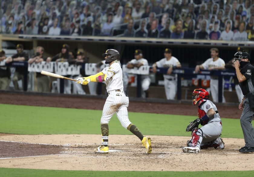 Fernando Tatis Jr. of the San Diego Padres hits a home run in last year's playoffs.