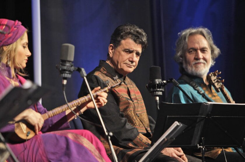 Iran's master of Persian classical music, Mohammad Reza Shajarian, center, performs during a 2011 concert in Dubai