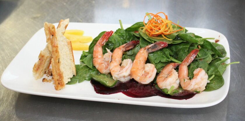 Piazza 1909's Mango Shrimp Salad with baby spinach, beets, caramelized walnuts and strawberry dressing.