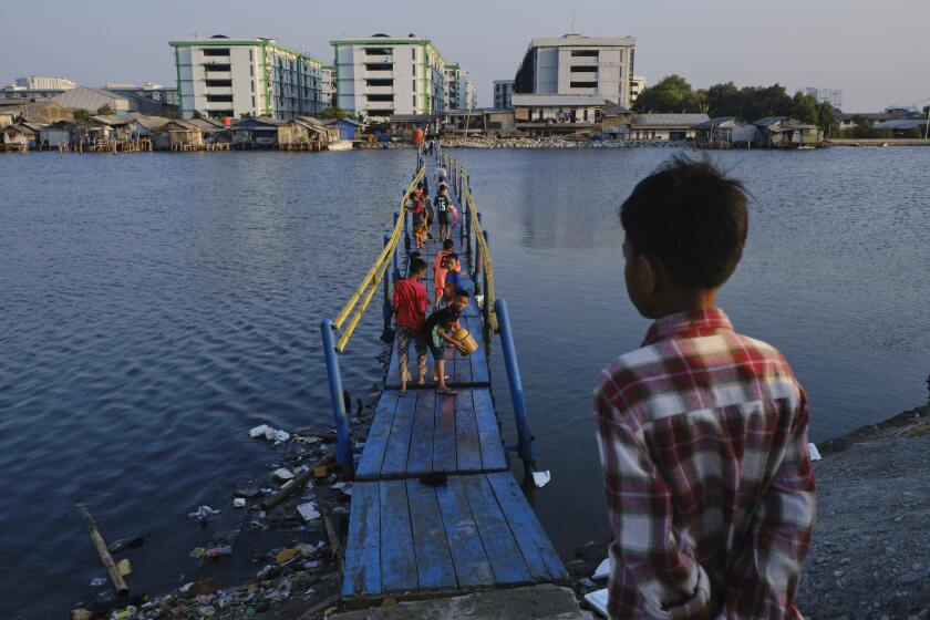 Indonesia Tackles Rising Waters At Jakarta's Sinking City