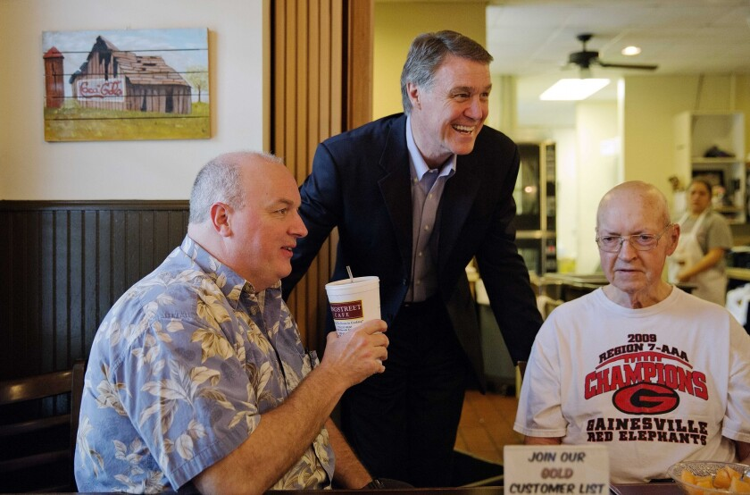 Georgia Republican Senate candidate David Perdue talks with voters during a campaign stop at Longstreet Cafe ahead of the state's May 20 primary election. (AP Photo/David Goldman)