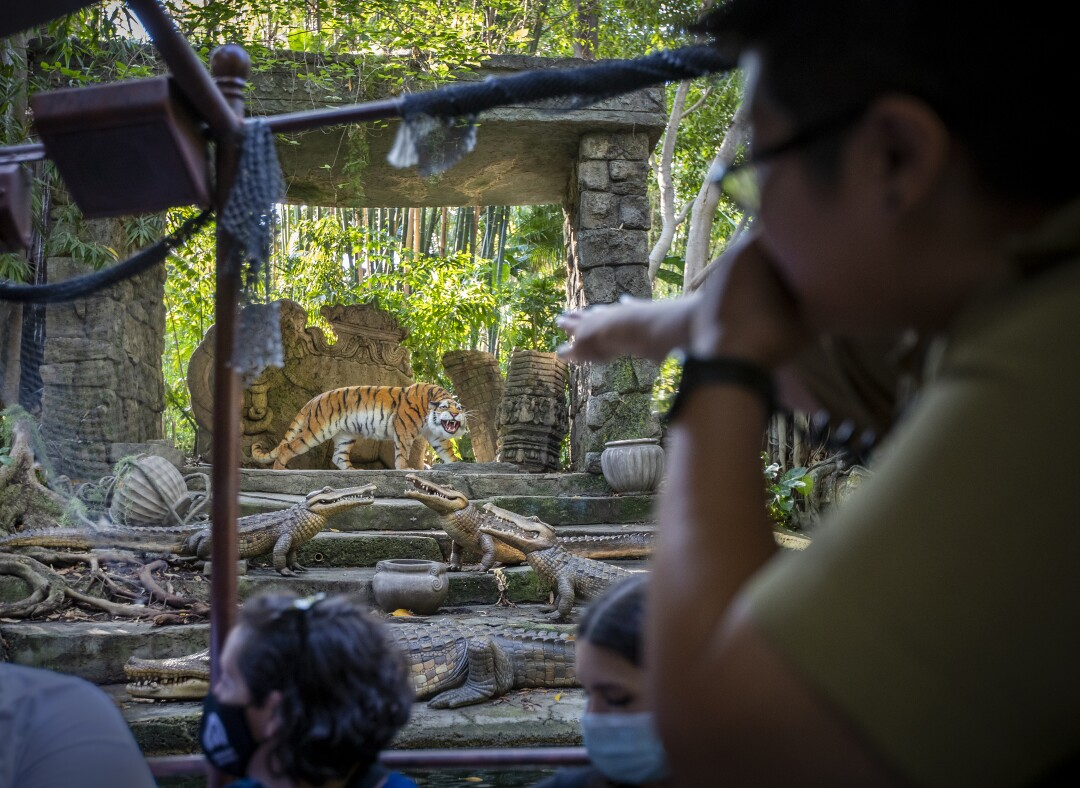 Skipper Amanda Beth Lorenzo leads guests on a journey past a Bengal tiger amid ruins on the Jungle Cruise