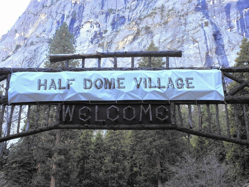 At Yosemite, a sign that used to welcome visitors to Curry Village now refers to Half Dome Village.