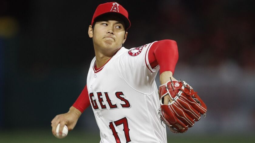 ANAHEIM, CALIF. -- TUESDAY, APRIL 17, 2018: Angles starting pitcher Shohei Ohtani delivers a pitch i