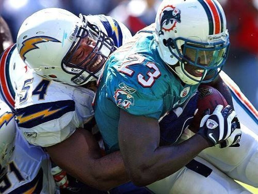 Linebacker and defensive captain Stephen Cooper makes a stop on Miami running back Ronnie Brown last weekend.