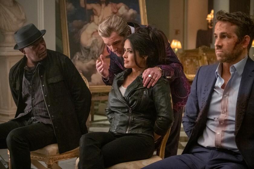"Samuel L. Jackson, Antonio Bandera, Salma Hayek and Ryan Reynolds in the the movie ""The Hitman's Wife's Bodyguard."""