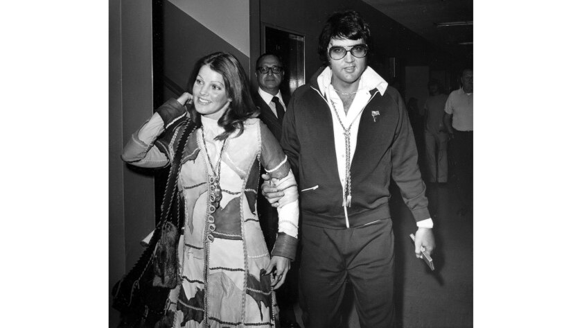 Oct. 9, 1973: Elvis and Priscilla Presley leave Los Angeles County Superior Court in Santa Monica after their divorce is granted by a judge.