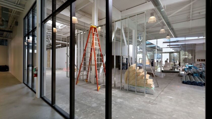 Professional and business services added 11,500 jobs in a year. Pictured: Interior view of a section of Walmart Labs' San Diego area offices under construction in the Make campus in Carlsbad.