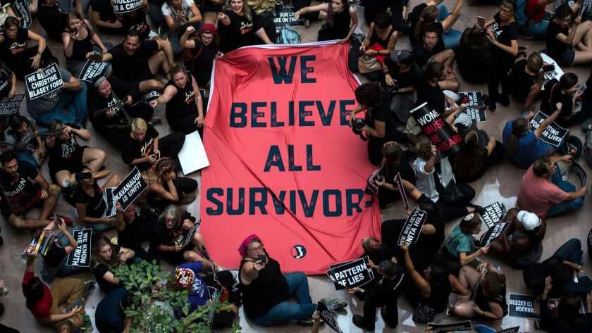Protesters unfurl a sign as they occupy the Senate Hart building during a rally against Supreme Court nominee Brett Kavanaugh on Capitol Hill in Washington, DC on October 4, 2018.