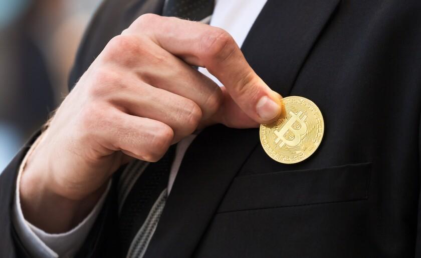 man holds golden bitcoin
