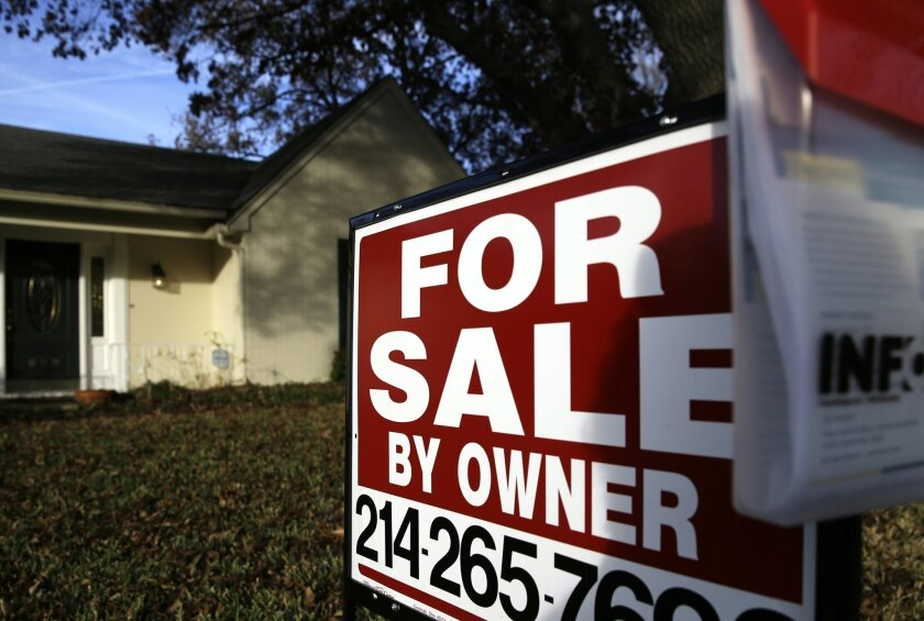 FILE - In this photo Dec. 16, 2014 file photo, a for sale by owner sign sits in front of a home in Richardson, Texas. Mortgage company Freddie Mac releases weekly mortgage rates on Thursday, April 2, 2015. (AP Photo/LM Otero, File)