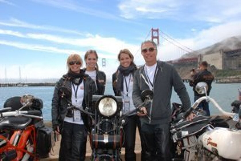 Scott Jacobs with is wife Sharon, and daughters Olivia and Alexa at the end of the race in San Francisco.