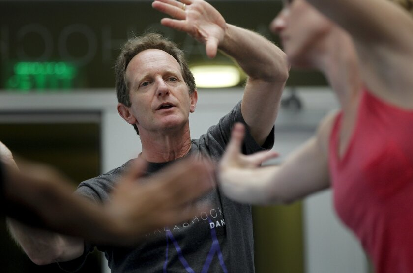 "During rehearsals at the Malashock Dance Studio in Liberty Station, John Malashock watches as dancers work through a move to be used in ""Malashock/RAW3,"" the third edition of the company's low-tech, high-emotion show that opens on Oct. 18."