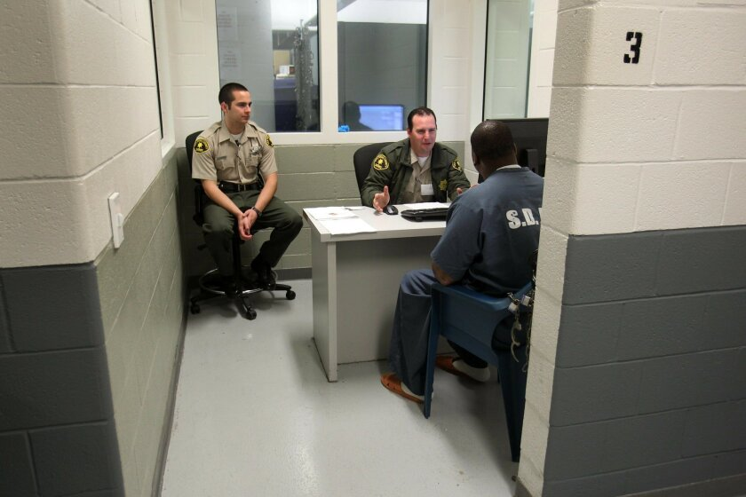 County sheriff's deputies have more inmates to monitor under a state law that gave local authorities more responsibility for lower-level criminals to ease crowding in state prisons. These deputies work at the Central Jail in downtown San Diego. l