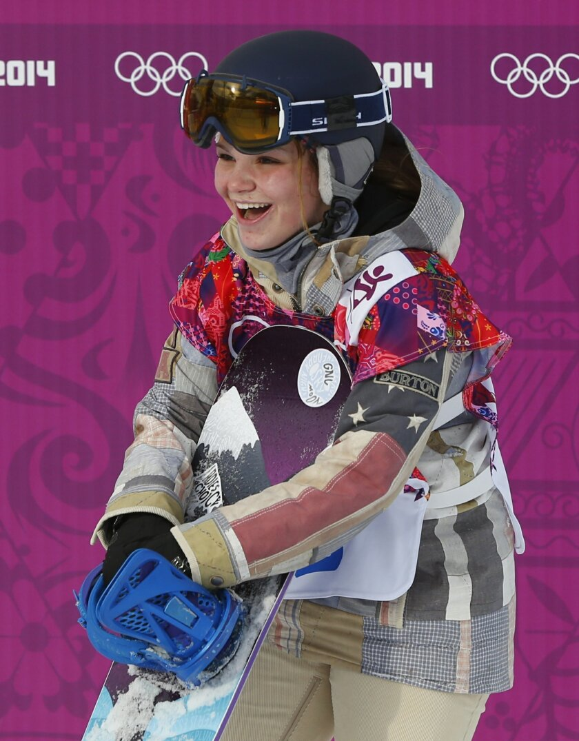 Ty Walker of the United States waits for her score during the women's snowboard slopestyle semifinal at the 2014 Winter Olympics, Sunday, Feb. 9, 2014, in Krasnaya Polyana, Russia. (AP Photo/Sergei Grits)