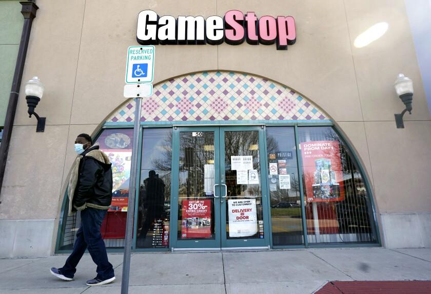 A pedestrian passes a GameStop storefront in Dallas.