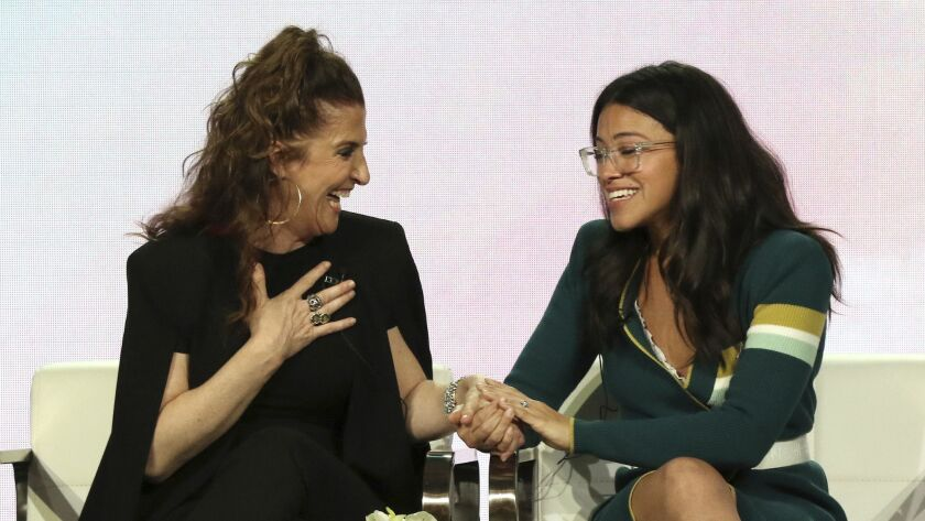 """""""Jane the Virgin"""" creator and executive producer Jennie Snyder Urman, left, and star Gina Rodriguez speak to each other in the """"A Final Farewell to 'Jane the Virgin'"""" panel during the Showtime TCA Winter Press Tour on Jan. 31, 2019."""
