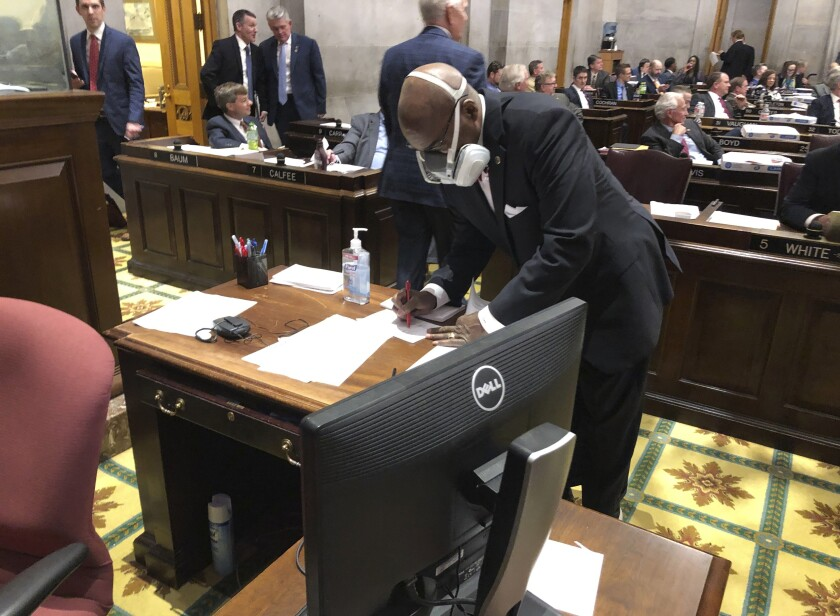 Tennessee State Rep. G.A. Hardaway wears a mask during legislative proceedings in Nashville in March. He is skeptical of the sharing of information with first responders about people who have tested positive for the coronavirus.