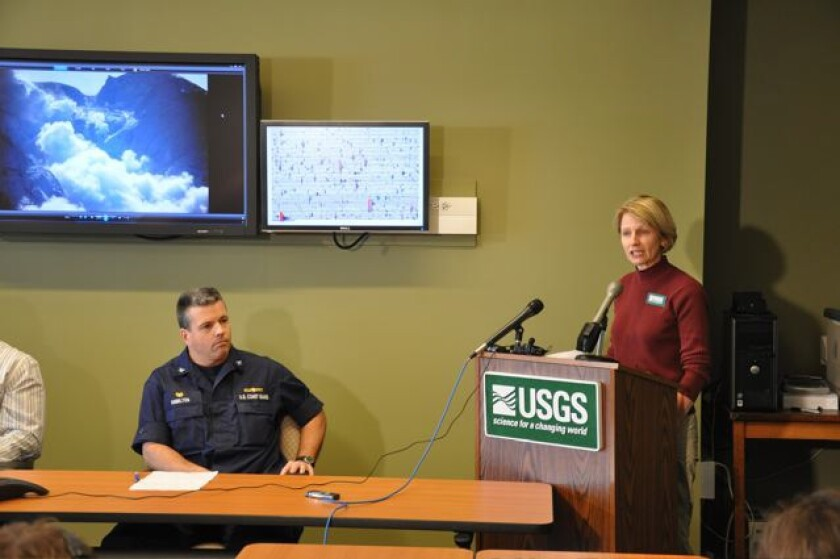 Margaret Mangan, on detail with the USGS Alaska Volcano Observatory, gives a media briefing during a 2009 eruption of Redoubt volcano in Alaska.
