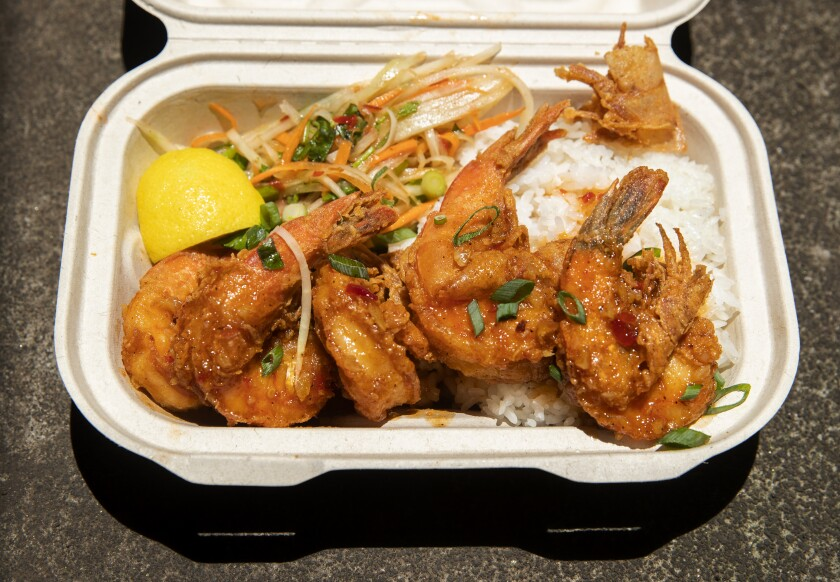 Garlic shrimp and rice is one of the specialties of the Litchon food truck at the farmers market in Hilo, Hawaii.