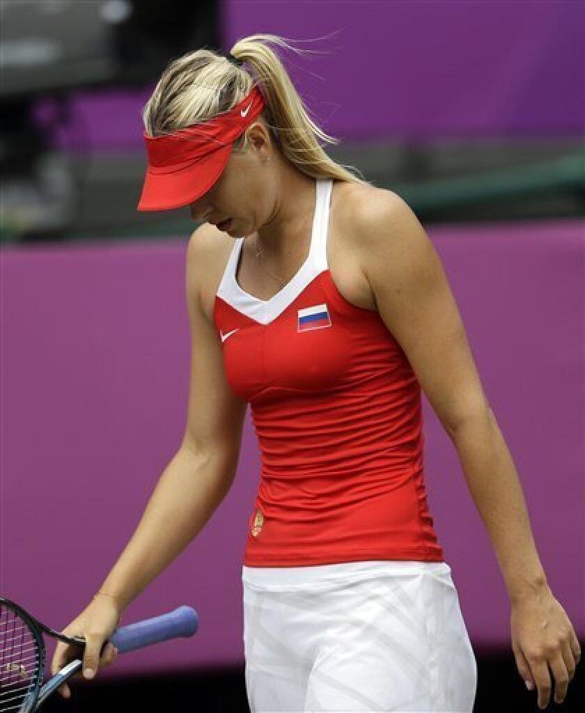Maria Sharapova of Russia reacts during her women's singles gold medal match against United States' Serena Williams at the All England Lawn Tennis Club at Wimbledon, in London, at the 2012 Summer Olympics, Saturday, Aug. 4, 2012. (AP Photo/Victor R. Caivano)