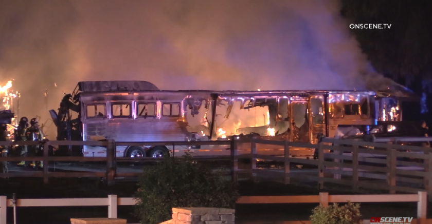 A trailer burns at Liz Bolton Stables in unincorporated San Marcos on Friday night.