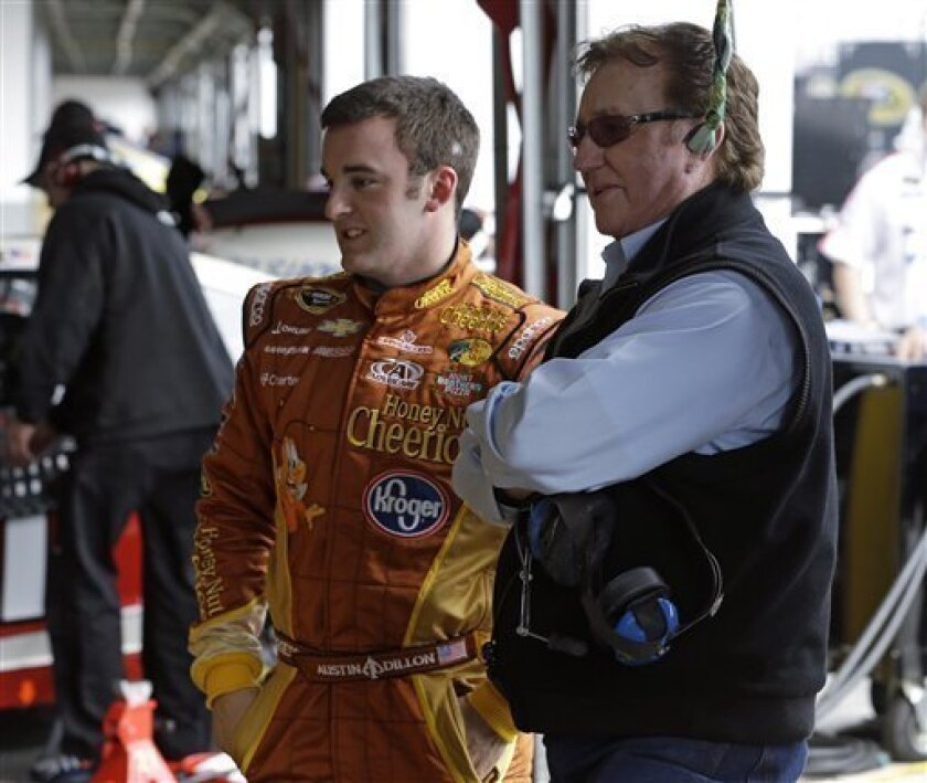 Austin Dillon, left, and team owner Richard Childress watch as crew members work on Dillon's car in the garage during a practice session for the NASCAR Daytona 500 Sprint Cup Series auto race at Daytona International Speedway, Saturday, Feb. 16, 2013, in Daytona Beach, Fla. (AP Photo/John Raoux)